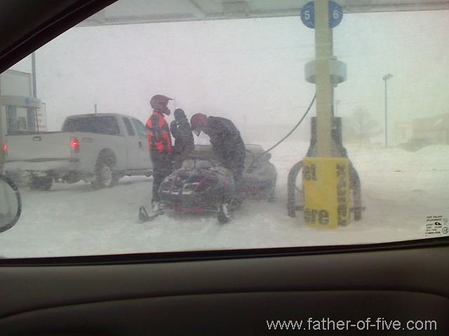 Snowmobile gassing up